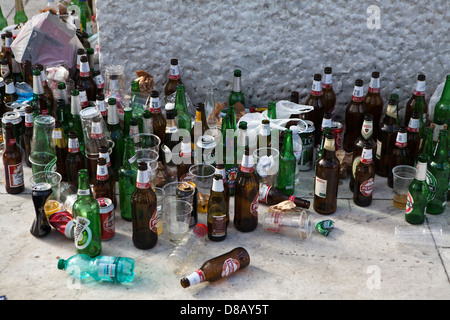 Empty beer bottles and cans left after rugby fans - Stock Photo