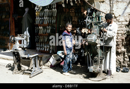 Shoemaker in the souks of Luxor in Egypt. - Stock Photo