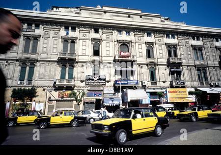 Taxis on Midan Orabi (Orabi Square) in Egyptian Alexandria. - Stock Photo