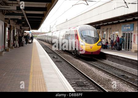 Virgin Pendolino arriving at Warrington Bank Quay Station - Stock Photo