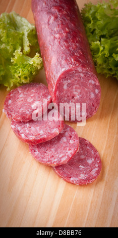 guts and tasty slices of smoked salami - Stock Photo