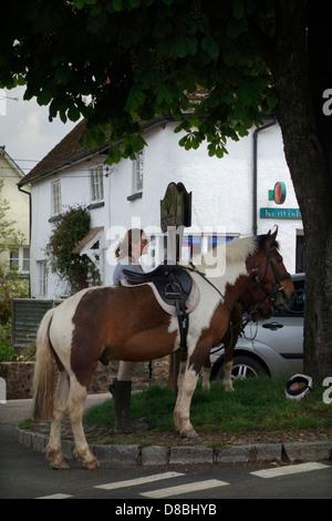 Kentisbeare village centre, Devon with ponies, village stores and post office - Stock Photo
