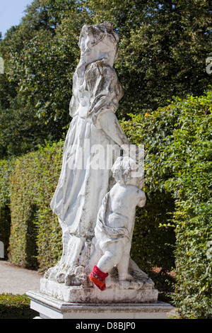 Baroque statue wearing a red hand-knitted sock in front of the Electoral Palace in Trier, Rhineland-Palatinate, - Stock Photo