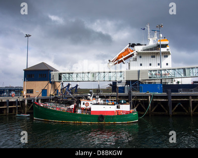 Scotland, Orkney Islands, Mainland Orkney. A variety of sea boats moored in Stromness Harbour on mainland Orkney. - Stock Photo
