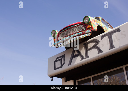 Colourfully painted Trabant on the roof of an art gallery - Stock Photo