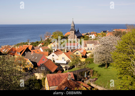 Gudhjem with church at the Baltic Sea on Bornholm in Denmark - Stock Photo