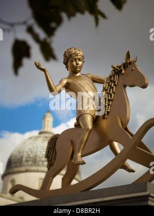 The boy on the rocking horse, Trafalgar Square, London, UK. - Stock Photo