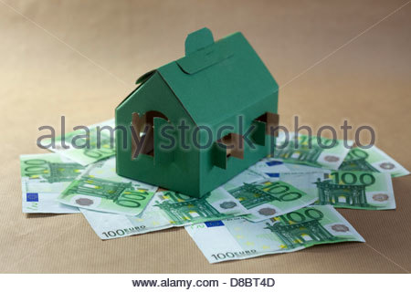 Close-up of a model home on 100 euro notes - Stock Photo