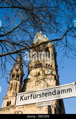 Kaiser Wilhelm Memorial Church (Kaiser Wilhelm Gedächtniskirche) and Kurfürstendamm street sign. - Stock Photo