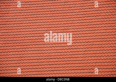 New red tiles roof close up detail. - Stock Photo