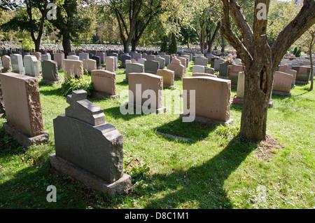 Gravestones in Montreal Cemetery - Stock Photo