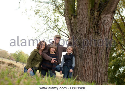 Portrait of a family enjoying in a garden, Bonn, Germany - Stock Photo