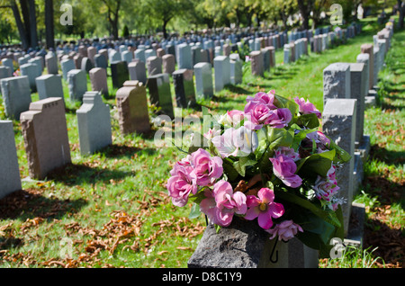 Gravestones and flowers in Montreal Cemetery - Stock Photo