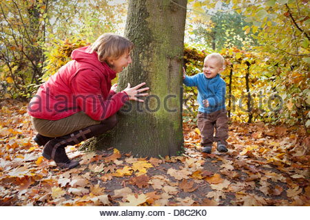 Mother and son playing in a garden, Bonn, Germany - Stock Photo