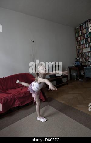 Girl dancing ballett in living room - Stock Photo