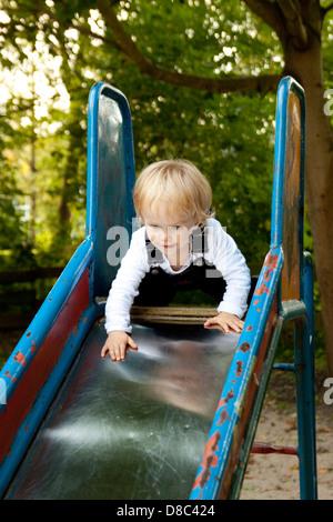Blond girl on slide