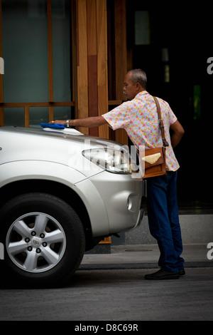 Man polishing a Car in Patong on Phuket, Thailand Stock