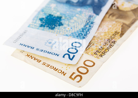 Two Norwegian 200 and 500 Kroner banknotes on a plain white background from Norway, Scandinavia, Europe - Stock Photo