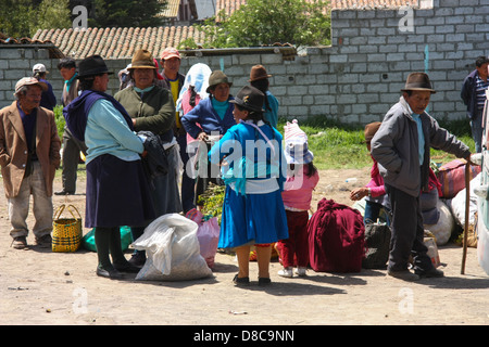 Old Quechua people waiting for the bus on a small market in Ecuador - Stock Photo