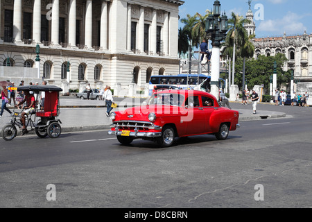 Old American Fifties Red Chevrolet Car Being Used As A Taxi For Local residents Of Havana Cuba - Stock Photo