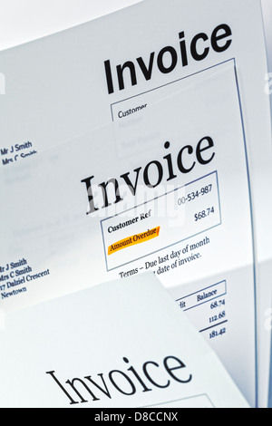 Invoice - three invoices, one with 'Amount Overdue' highlighted. - Stock Photo