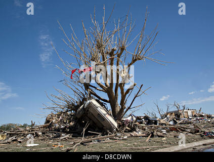 A car rests in the wreckage of a home in the aftermath of an EF-5 tornado May 22, 2013 in Moore, Oklahoma. The massive - Stock Photo