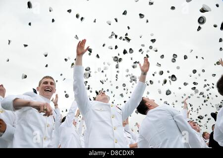 US Naval Academy graduates toss their hats following the Class of 2013 graduation and commissioning ceremony May - Stock Photo