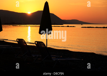 Golden sunset over the hills of Akamas peninsula as seen from Latchi beach, Paphos area, Cyprus - Stock Photo