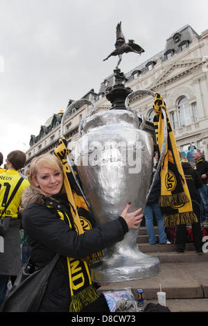 London, UK. 25th May 2013.  Saskia Linde, 28, from Dortmund holds a large replica of the cup. Borussia Dortmund - Stock Photo