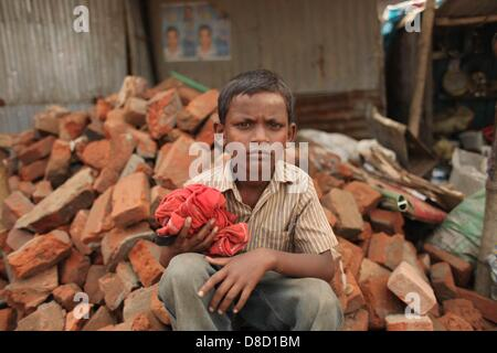 Dhaka,bangladesh 25th may 2013; 'swapon' a 8 years old boy who collects bricks from street & sell them.every day - Stock Photo