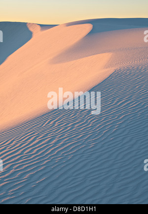 Dawn color on dune face, White Sands National Monument - Stock Photo