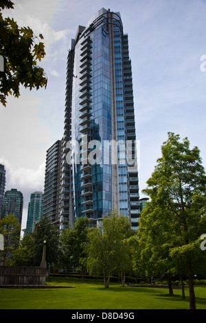 Example of a high-rise tower, with a lone window washer, in downtown Vancouver, Canada - Stock Photo