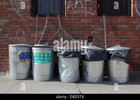 garbage cans on sidewalk - Stock Photo