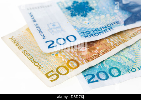 Three Norwegian 200 and 500 Kroner banknotes on a plain white background from Norway, Scandinavia, Europe - Stock Photo