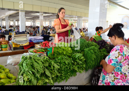 Women selling vegetables at  Siob Bazaar in Samarkand - Stock Photo