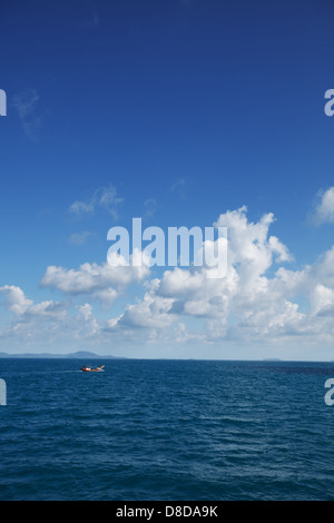 Small old fishing boat in the ocean. Thailand - Stock Photo