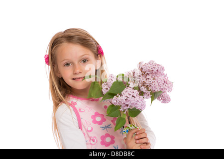 887077e7b165a ... Happy little girl with long hair wearing summer dress and holding lilac  flowers. Isolated on