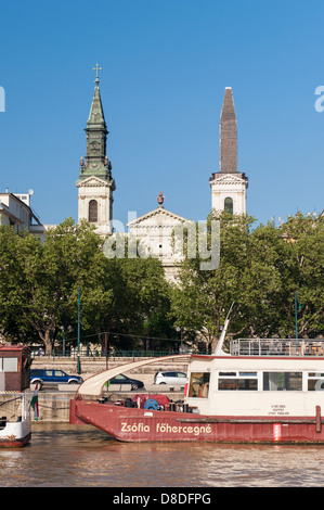 Hungary Budapest view from River Danube of quay & promenade & boat ship Petofi Templon Greek Orthodox Church built - Stock Photo