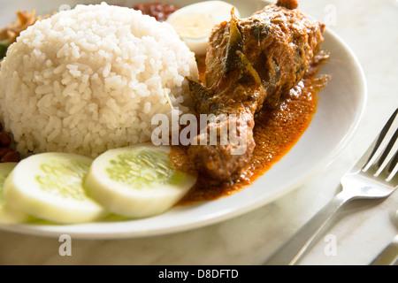 'Nasi Lemak' - A popular meal found in Malaysia. - Stock Photo