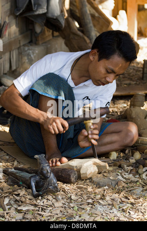 Carving Burmese marionettes in Mandalay, Myanmar 6 - Stock Photo