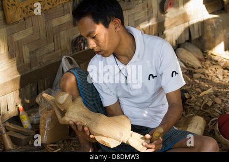 Carving Burmese marionettes in Mandalay, Myanmar 7 - Stock Photo