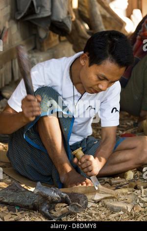 Carving Burmese marionettes in Mandalay, Myanmar 3 - Stock Photo