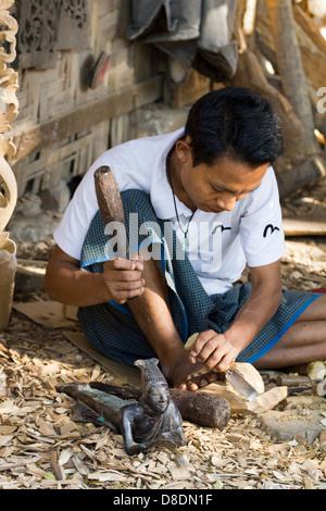 Carving Burmese marionettes in Mandalay, Myanmar 2 - Stock Photo
