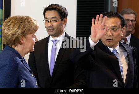 German Chancellor Angela Merkel, Vice Chancellor and Economy Minister Philipp Roesler and Chinese Premier Li Keqiang - Stock Photo