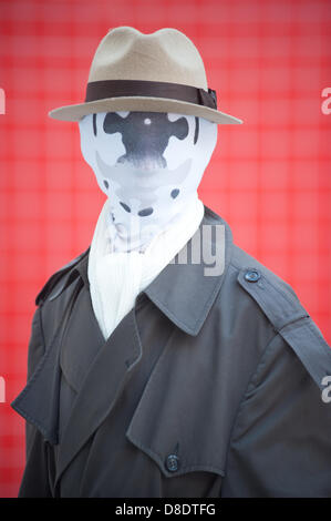 London, UK - 26 May 2013: David Mcghee dressed as Rorschack of Watchman poses for a picture during the London Comic - Stock Photo