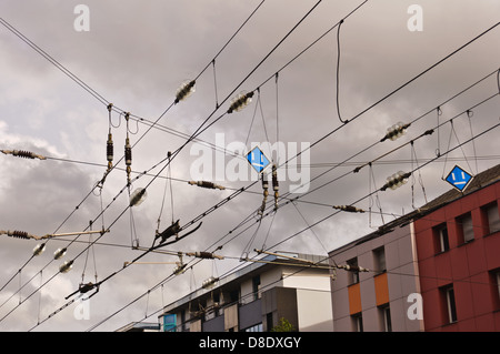 Catenary, contact wires, against thunderstorm and rain clouds - Stock Photo