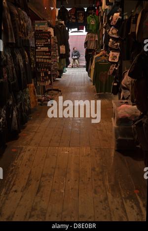 Market trader in Camden Market. - Stock Photo