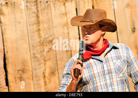 SOUTHWEST - A cowboy takes time to rest and reflect. - Stock Photo