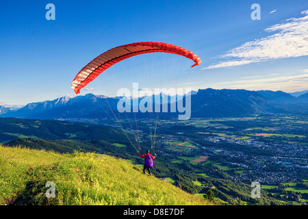 Paraglider starting at Gaisberg above the city of Salzburg, Austria - Stock Photo