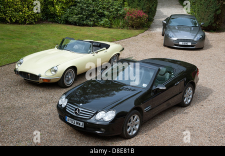 Expensive luxury cars on a driveway - Stock Photo